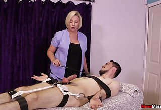Strict blonde masseuse gives a Femdom handjob apropos a bound client