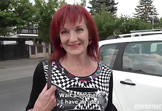 Red haired mature woman is sucking a steadfast cock nearby a public place, after riding level with