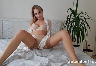 Alone emotional and bonny hottie in neutral stockings Siya masturbates pussy