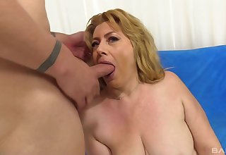 Seductive nude mature gags and fucks like she's 18 again