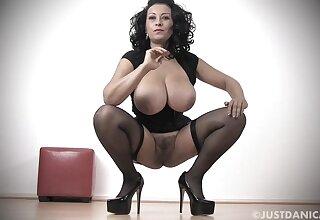 Busty MILF Danica Collins nigh stockings and high heels playing