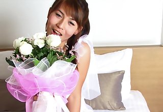 Young Thai shemale bride Jiw on the video with her bridal bouquet.