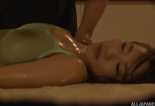 Oiled prevalent busty Japanese babe missionary pounded and creampied