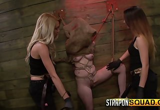 Two mistresses wearing strapons fuck scheduled up and restrained hooker Sheena Rose