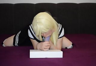 Cute schoolgirl sucks bon-bons dildo.