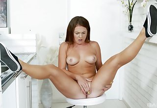 Tanned babe loves feeling her pussy so wet