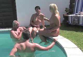 Mature amateurs fucked by be imparted to murder pool by their mature husbands